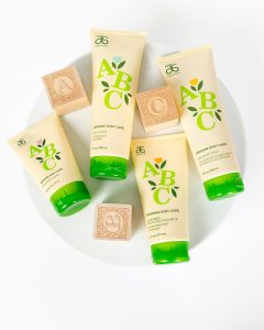 Arbonne's ABC care line including diaper rash cream, shampoo, lotion, and baby sunscreen