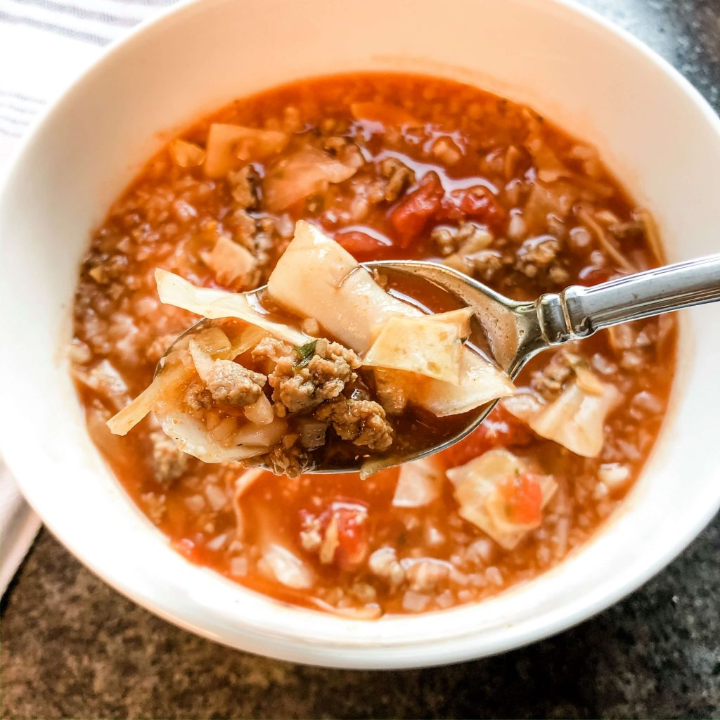 slow cooker gluten free cabbage soup with spoon