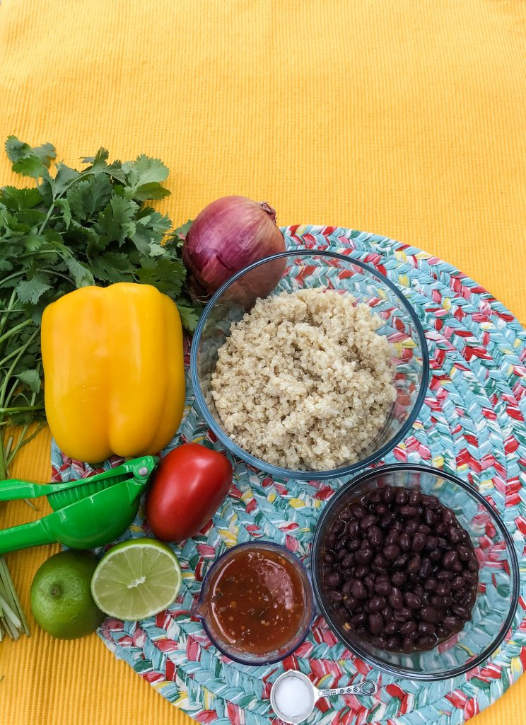 Ingredients for Mexican Quinoa with quinoa black beans salsa salt lime tomato pepper and onion