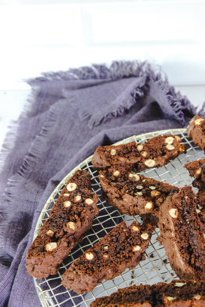 chocolate hazelnut biscotti cooling on rack with blue towel