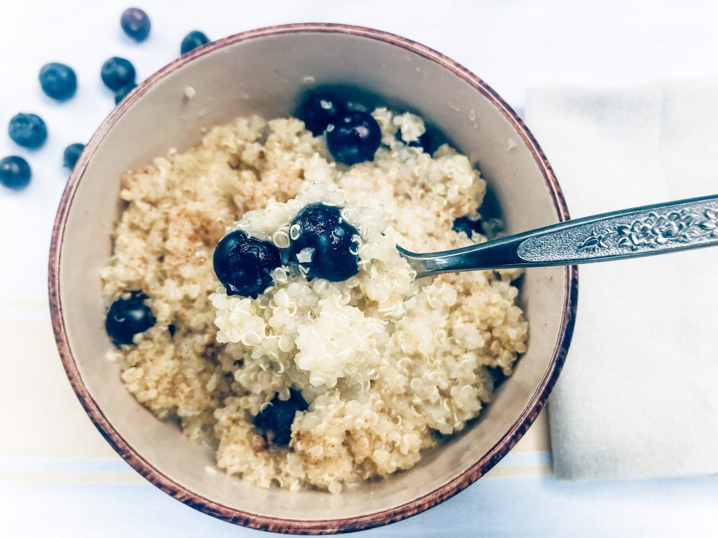 Microwave Breakfast Quinoa finished picture topped with cinnamon and blueberries