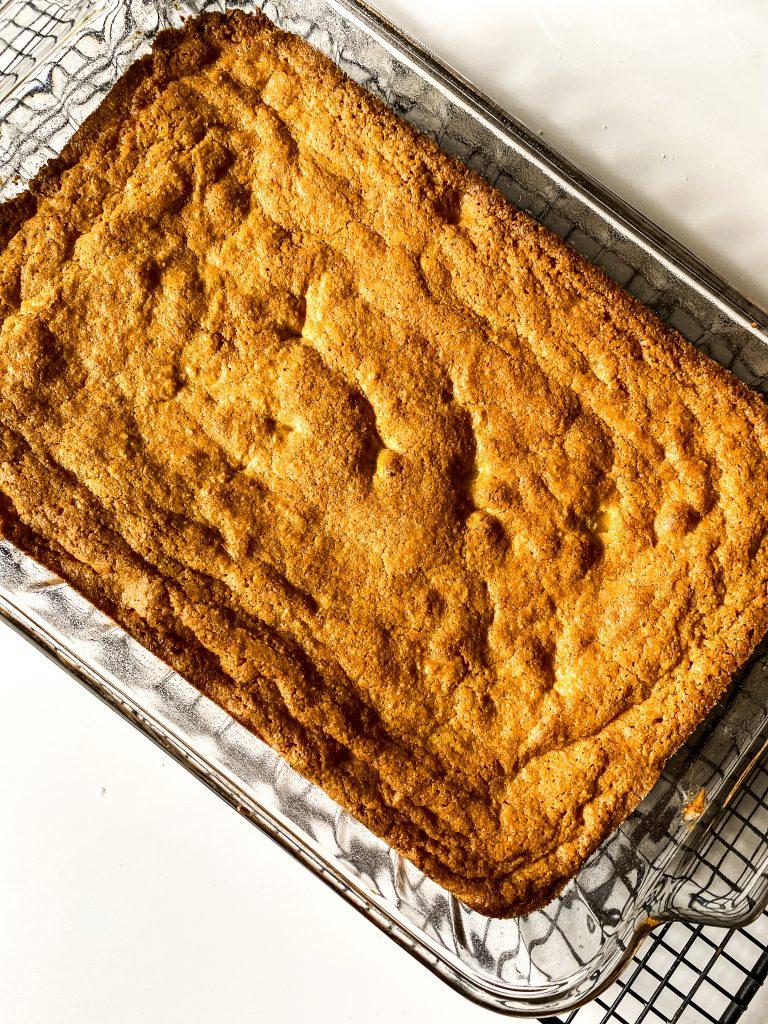 baked gluten free blondies in pan, cooling