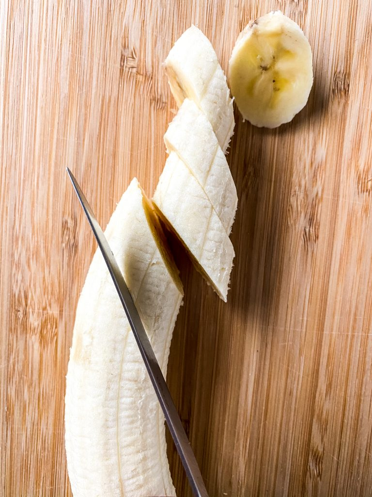 slicing banana with knife