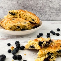 lemon blueberry scones cut and on plate side view