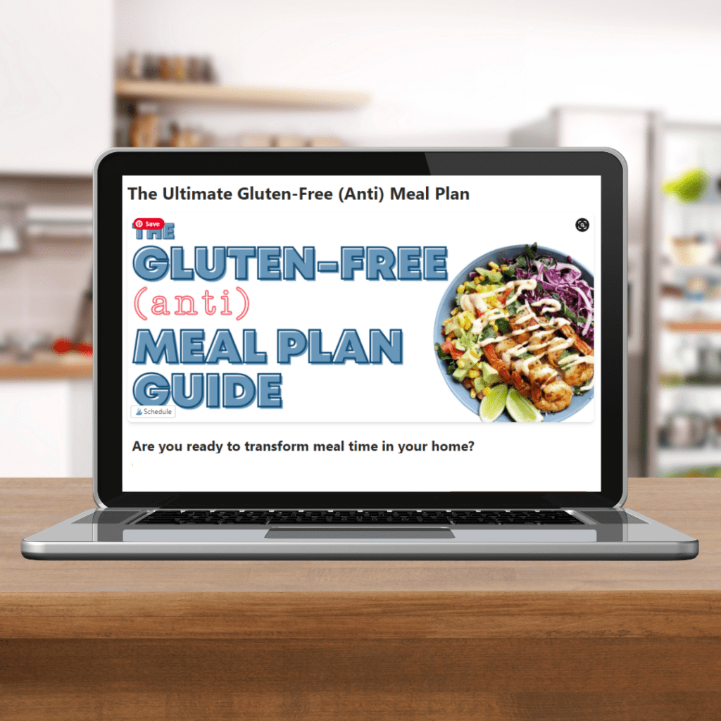 laptop on kitchen counter with (anti) meal plan mock up