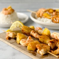 marinated gluten free shrimp and pineapple on skewers and over rice