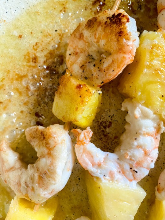 shrimp and pineapple cooking in pan