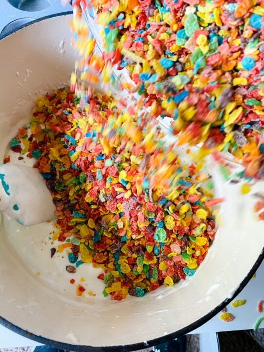Stirring Fruity Pebbles into Marshmallows in Dutch Oven